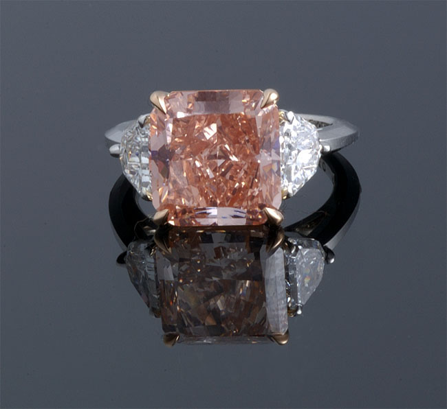 Pink diamond ring with white diamond accents